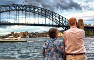 Retired couple overlooking the Sydney Harbour Bridge