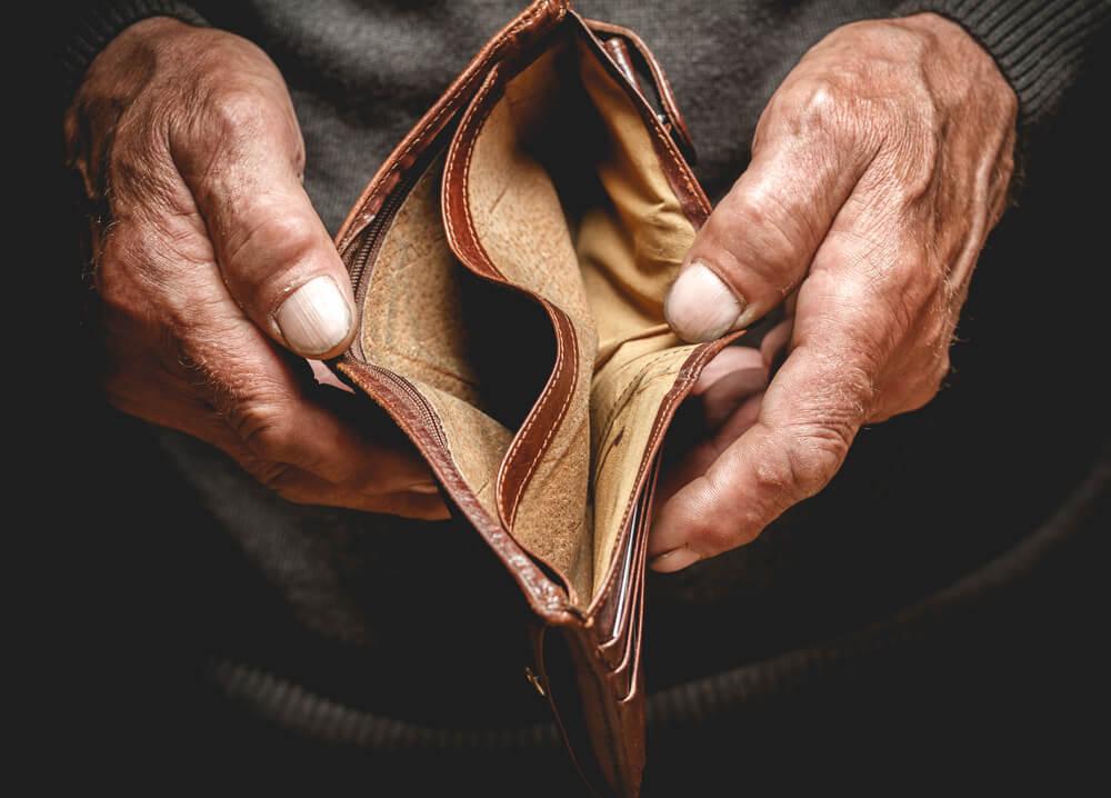 retiree holding open empty wallet