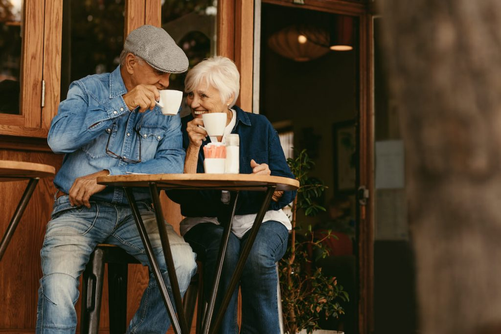Retired couple enjoying coffee together