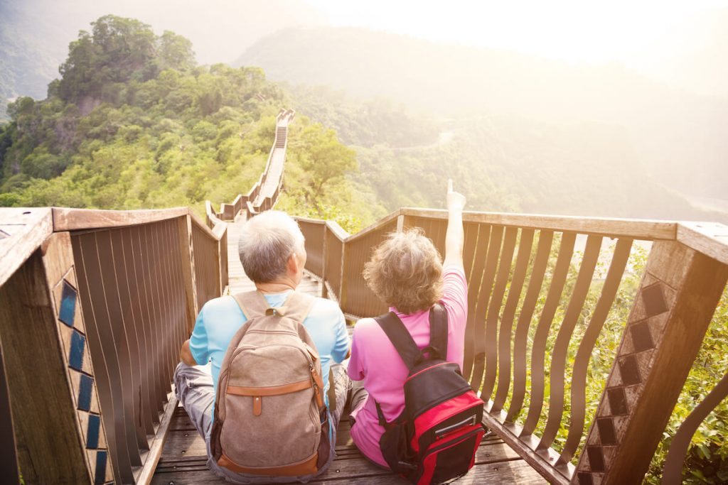 Retired couple on hiking holiday