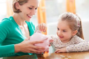 mother and daughter working on budgets