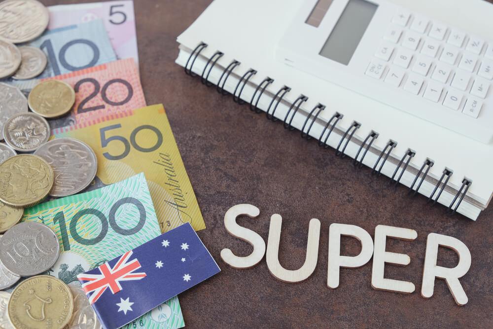 australian money next to notepad